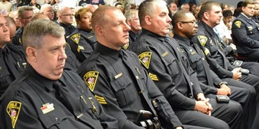 police offices sitting in conference meeting